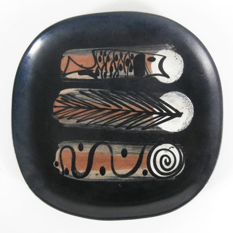 """african"" plate with fish, feather & spiral"