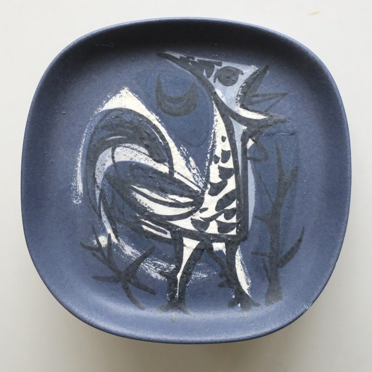 dark blue plate with rooster