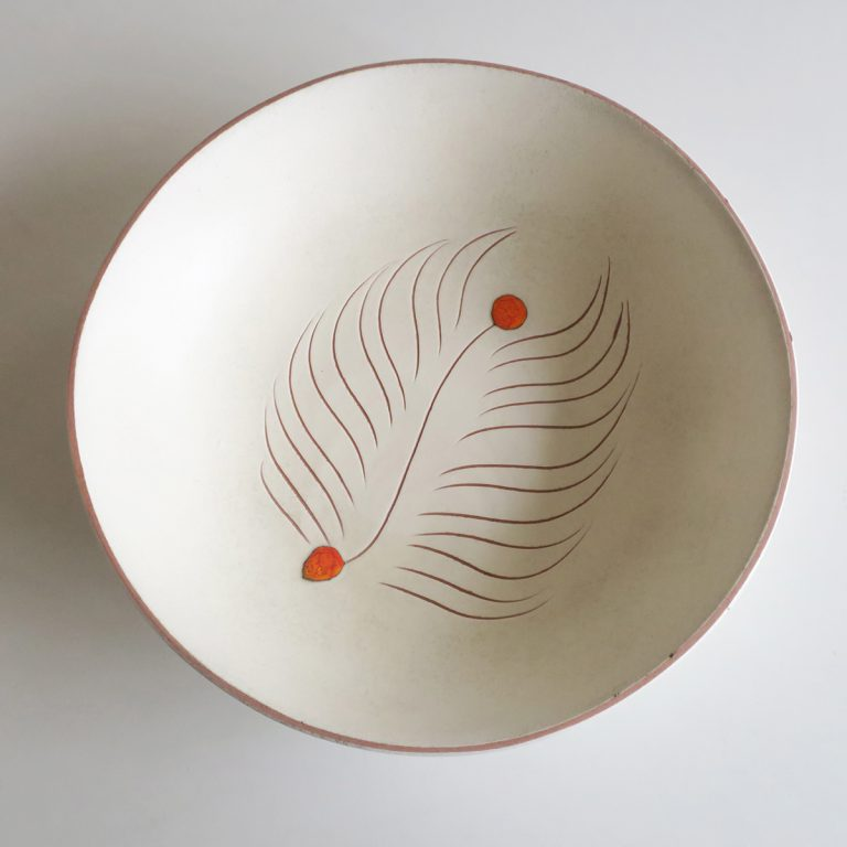 white salad bowl with leaf